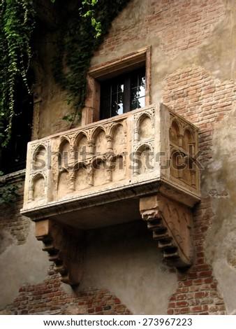 Exterior details of Romeo and Juliets balcony on side of historic house, Verona, Veneto, Italy. - stock photo