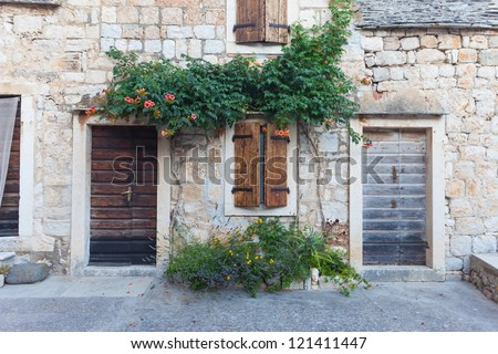 Exterior of a Beautiful Stone Cottage. - stock photo