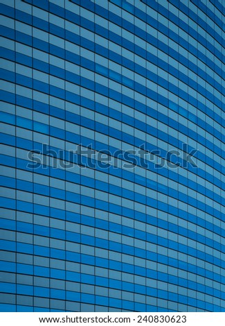 Exterior of a curved office building with glass windows - stock photo