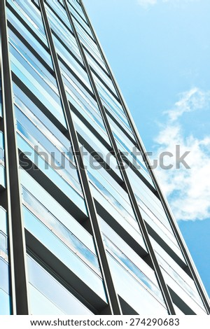 Exterior of a modern building against a blue sky - stock photo