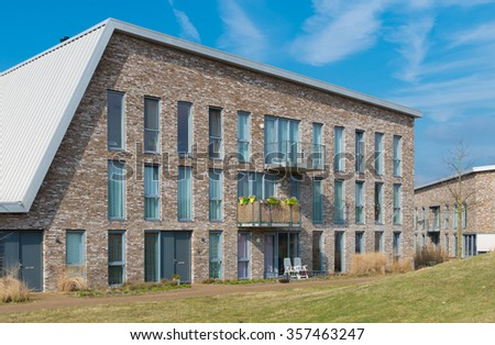 exterior of a modern residential apartment building in the netherlands - stock photo