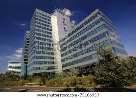 Exterior of a modern skyscraper, office building - stock photo