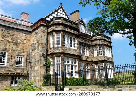 Exterior of a traditional English manor house. - stock photo