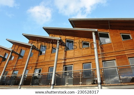 Exterior of a Wooden Terraced Apartment Building - stock photo
