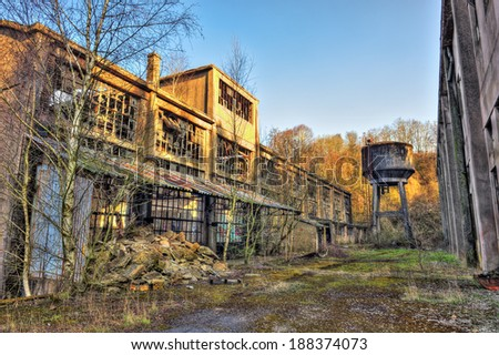 Exterior of an abandoned factory building, hdr processing - stock photo