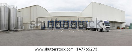 Exterior of distribution warehouse with logistics center - stock photo