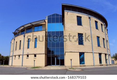 Exterior of empty modern office building available for lease or rent with blue sky background. - stock photo