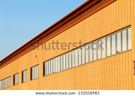 Exterior of industrial building on a sunny day - stock photo