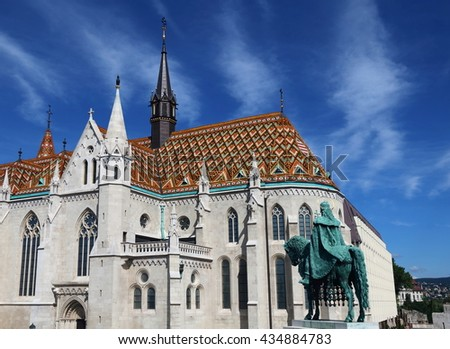 Exterior of Matthias Church, with the statue of King Stephen in the foreground, Budapest, Hungary - stock photo