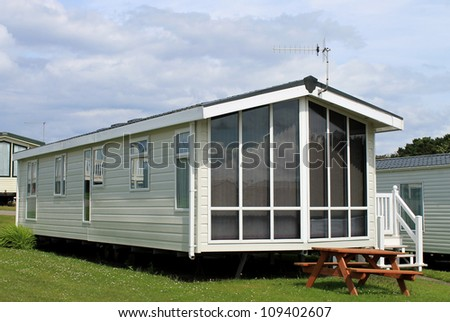 Exterior of modern caravan, trailer or mobile home in park - generic one available for hire. - stock photo