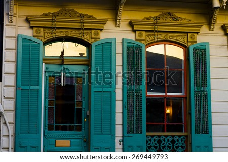 Exterior of moody windows on a New Orleans style home. - stock photo