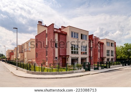Exterior of newly made modern architecture residential building - stock photo