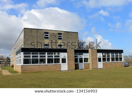 Exterior of secondary comprehensive school with blue sky and cloudscape background. - stock photo