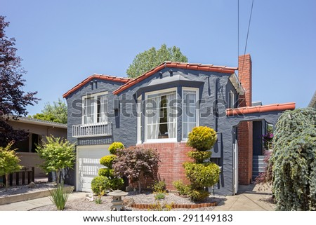 Exterior of Spanish style California home in grey. - stock photo
