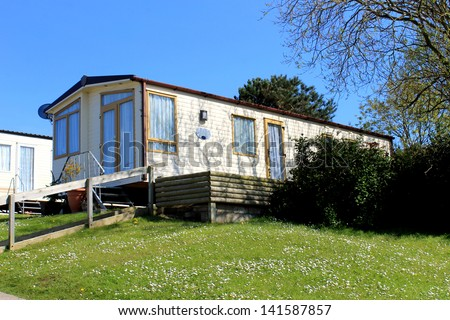 Exterior of static caravan in modern trailer park. - stock photo