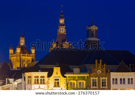 Exterior of the gothic medieval cathedral of Saint John, at night with old houses in front, one of the top attractions of Den Bosch, 's-Hertogenbosch, Netherlands - stock photo