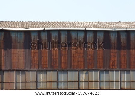 Exterior Old warehouse building in factory zone - stock photo