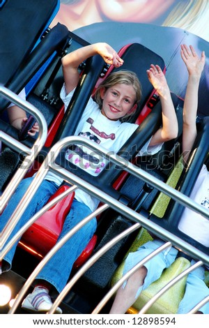exterior portrait of girl at fun fair - stock photo