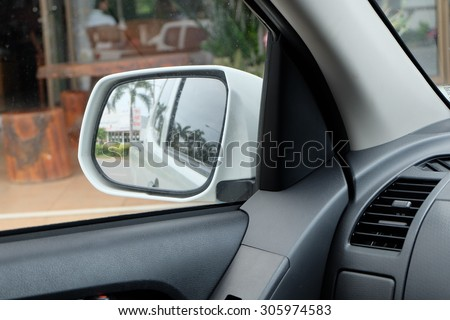 Exterior side mirrors of cars viewed from inside the car. - stock photo