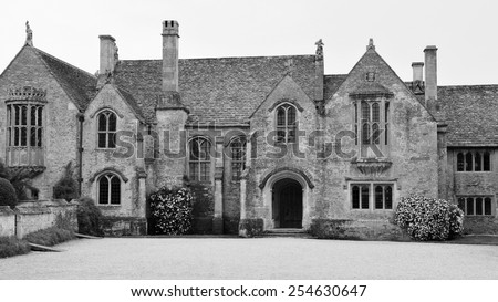 Exterior View of an Old English Manor House in Black and White - stock photo