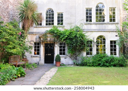 Exterior View of an Old English Rural House and Garden - stock photo