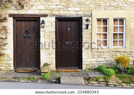 Exterior View of Old English Stone Cottages - stock photo