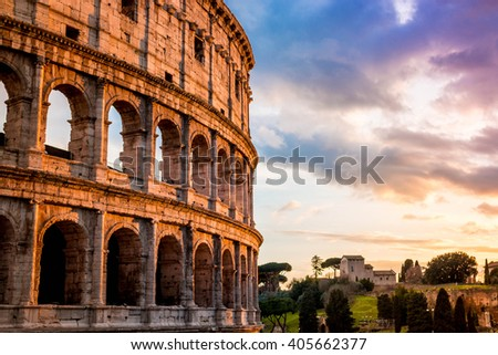 Exterior view of the Colosseum and nearby Palentine Hill at the golden hour - sunset - stock photo