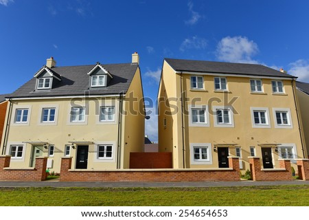 Exterior View of Town Houses on a Typical English Residential Estate - stock photo