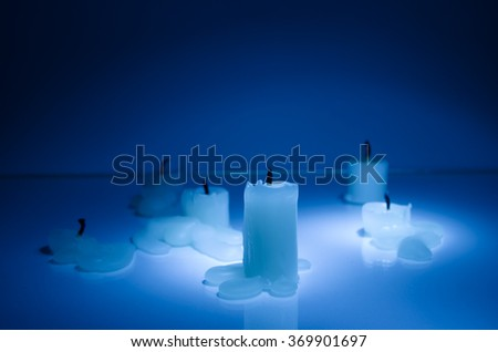 Extinguished candles in blue - stock photo