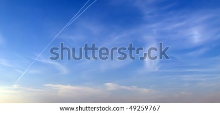 extra large panorama image of cirrus clouds on blue sky - stock photo
