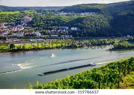 Extra long barge ship is transporting coal on Rhine river near Bingen am Rhein and Ruedesheim, Hessen, Germany - stock photo