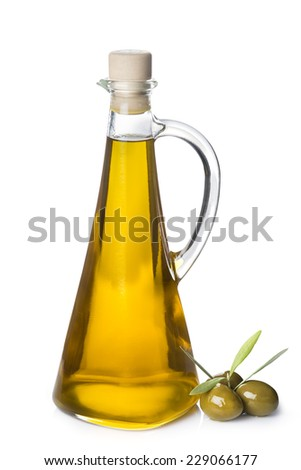 Extra olive oil bottle and green olives with leaves isolated on a white background - stock photo