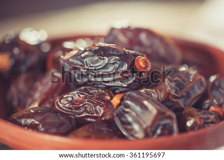Extra sweet medjool dates in rustical bowl - stock photo