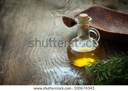 Extra virgin healthy Olive oil with fresh olives on rustic wooden background - stock photo