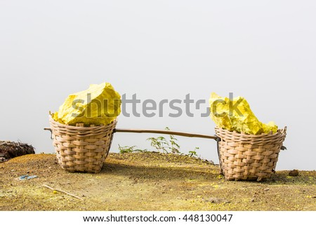 Extracting sulphur inside Kawah Ijen crater, Indonesia - stock photo