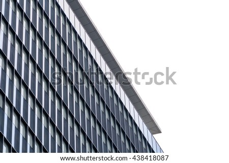 Extreme close up building windows texture. Low angle view of modern commercial office building with vertical windows, architectural exterior against white sky. - stock photo