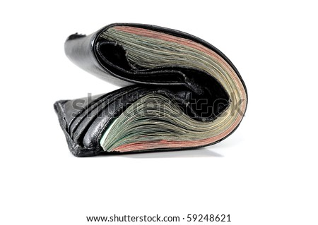 Extreme close-up image of a wallet full of money - stock photo