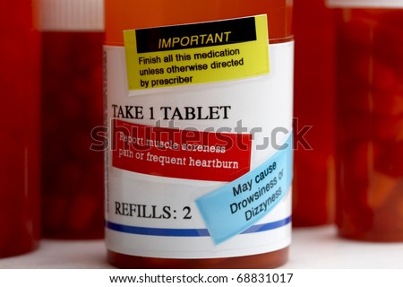 Extreme close-up of amber prescription bottle with labels - stock photo