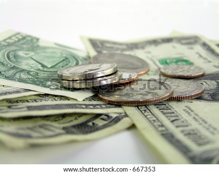 extreme close up of pile of bills and change on white - stock photo