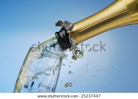 Extreme close-up of pouring champagne in glass - stock photo