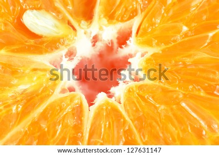 Extreme close-up of sliced tangerine. - stock photo