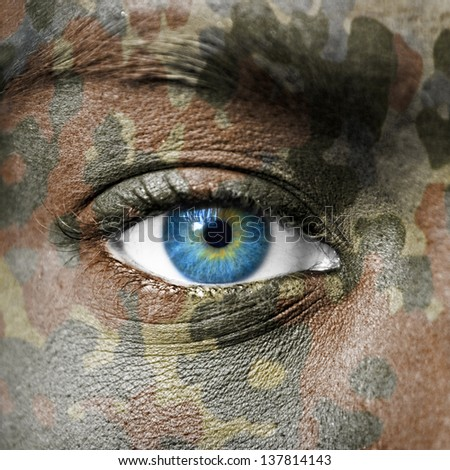 Extreme close up of soldiers eye - stock photo