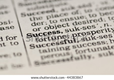 Extreme close up of the word SUCCESS found inside a dictionary - stock photo