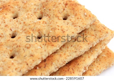 Extreme close-up of whole wheat saltine crackers - stock photo