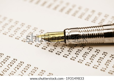 Extreme close up shot of pen on money table - stock photo