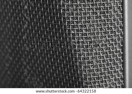 extreme closeup of memebrane of vintage microphone - stock photo