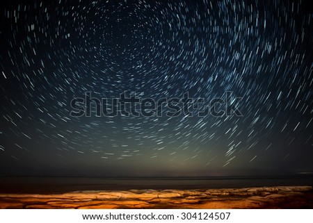Extreme long exposure image showing star trails around the Polar Star or Polaris over Selmun in Malta - stock photo