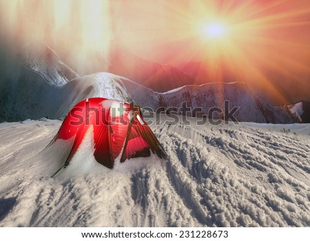 Extreme overnight in the snowy mountains after a fierce storm on the eve of the New Year, when a lot of snow fell on the slopes and tree branches, threatening danger of avalanches - stock photo