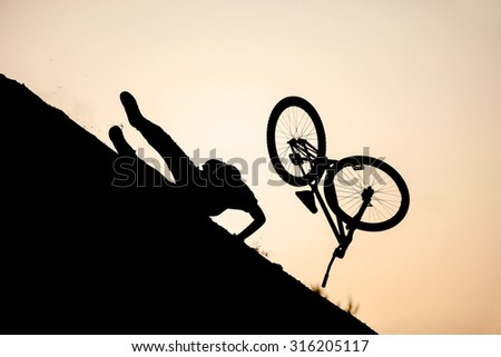 Extreme rider falling while performing a bike jump - stock photo