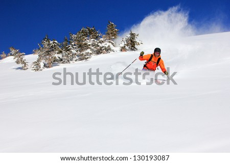 Extreme skier skiing fast in deep powder snow, Utah, USA. - stock photo